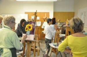 students paint still life
