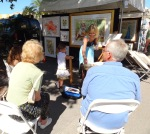 AIP-Nov-Art in the Park guests pulled up a chair to watch Terri Clemente paint