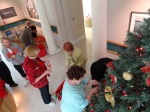 The NAA staff works together to deck the halls at The von Liebig Art Center.