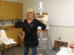 Instructor Anne Chaddock models the new Wine and Dezine paint smocks.