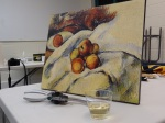 "Wine and Dezine workshop students created their own versions of this Paul Cezanne painting, ""Apples on a Sheet."""