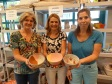 Rochelle Moore, Betsy Dawson, and Tracy Pospeck, board members of Empty Bowls Naples, came to glaze a few ceramic bowls with the Naples Art Association.