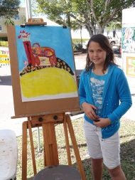 Sofia Feeney with her finished oil pastel. Photo credit: Ken Kaminsky