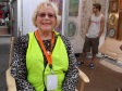 Volunteer Judy Dolan gives artist Bonny Hawley a short break as a booth sitter at the new years art fair