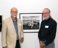 "Photographic Artist Tony Hertz next to his winning black and white photo, ""Gnarled Wave,"" with one of the three show jurors, Ron Bishop."