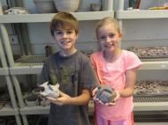 Braxton Eisel and Jordan Taft show their creative clay creations.