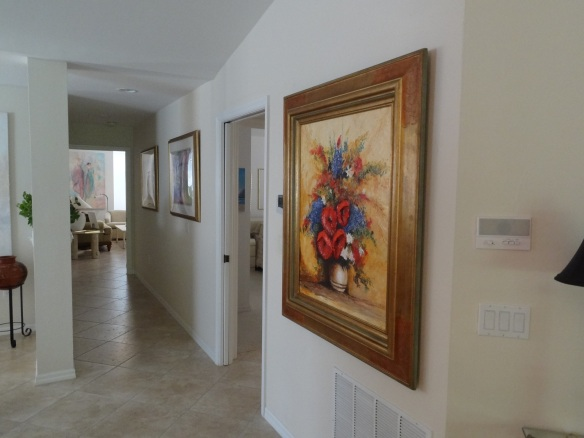 Mary Mariner's home is filled with her artwork even from the entrance. This gorgeous piece wows guests at the top of the stairs. Her studio is at the end of the hallway shown here.