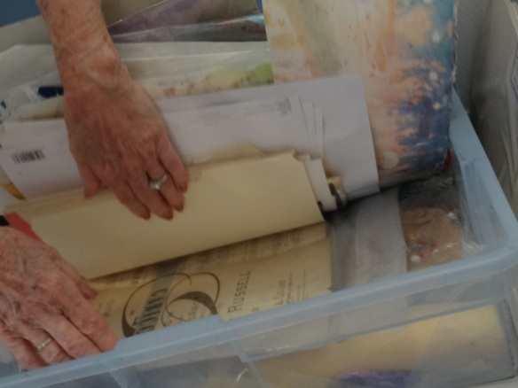 She still collects interesting paper from secondhand stores and other sources to be used in her work. She saves it in this bin in her studio.